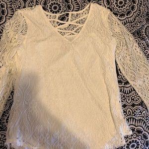 White lace, crisscross top.